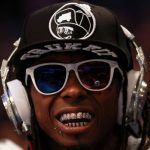 ORLANDO, FL - FEBRUARY 26:  Hip-hop artists Lil' Wayne, wearing diamond studded beats headphones by Dr. Dre sits courtside during the 2012 NBA All-Star Game at the Amway Center on February 26, 2012 in Orlando, Florida.  NOTE TO USER: User expressly acknowledges and agrees that, by downloading and or using this photograph, User is consenting to the terms and conditions of the Getty Images License Agreement.  (Photo by Ronald Martinez/Getty Images)