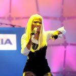 NEW YORK, NY - APRIL 06:  Nicki Minaj performs as Times Square was brought to a standstill on April 6, 2012 as Nicki Minaj teamed up with Nokia to perform live for the launch of the Windows Phone-based Nokia Lumia 900 in North America, in New York City. Tens of thousands of people watched Nicki perform a medley of her hits before a prominent Times Square building was turned into a living, breathing entity in time to the unique Nokia Lumia 900 remix of her hit single �Starships�. The building appeared to fill with water before a 60ft waterfall was seen to cascade down the side of the building. The reaction of the crowd was shown on nine massive electronic screens around the famous square making it one of the biggest LED displays ever seen and will be used in the video of Nicki�s new Nokia Lumia 900 remix of �Starships�. The singer said: ⤽When Nokia came to me with the idea to make a building come alive and to perform in Times Square in front of my fans to celebrate the launch of the Nokia Lumia 900 there was only ever one answer. To see the idea on paper was amazing but to see it for real blew me away. It brought Times Square to a standstill. The absolute bonus for me is that my fans, who have been so loyal to me, are now part of the video for the Starships Nokia remix. Performing in my home town of NYC the same week as the release of my new album, Pink Friday: Roman Reloaded is amazing and it really is a dream come true.⤝  The Nokia Lumia 900 will be available in unique and eye-catching cyan blue and a matte black with a new high-gloss white version on sale later this month. To watch more of the amazing event go to www.facebook.com/nokiaus  (Photo by Jason Kempin/Getty Images for Nokia)